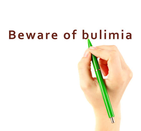 bulimia: Human hand writing text Beware of Bulimia on transparent whiteboard Stock Photo