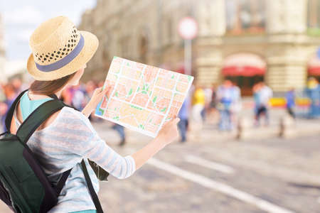 guid: Traveler with map on city background Stock Photo