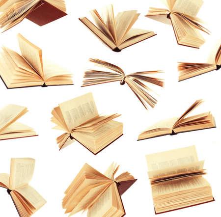 Muchos libros de vuelo como fondo aislados en blanco Foto de archivo