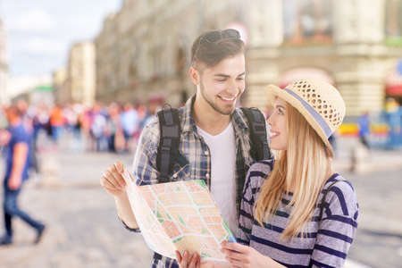 Young couple of travelers in the city, outdoors Stock Photo