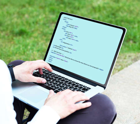 programer: Man using laptop, writing programming code on laptop