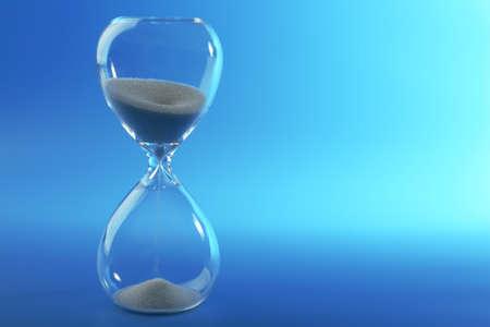 reloj de arena: Reloj de arena sobre fondo azul