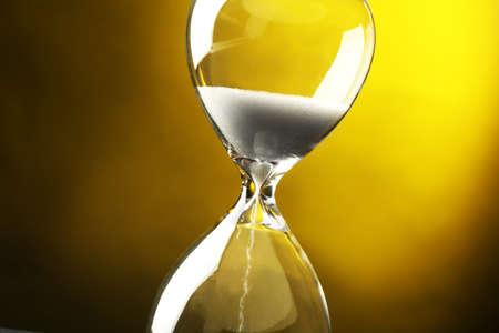 hourglass: Hourglass on dark yellow background