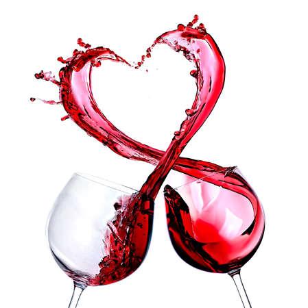 Dvě sklenky červeného vína. Heart Splash Reklamní fotografie