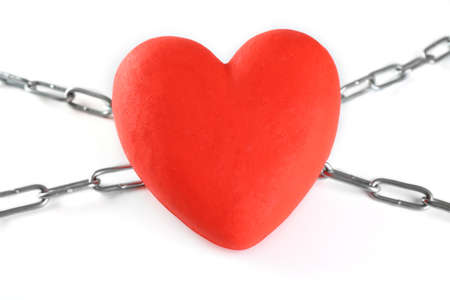 heavy heart: Red heart with metal chain isolated on white Stock Photo