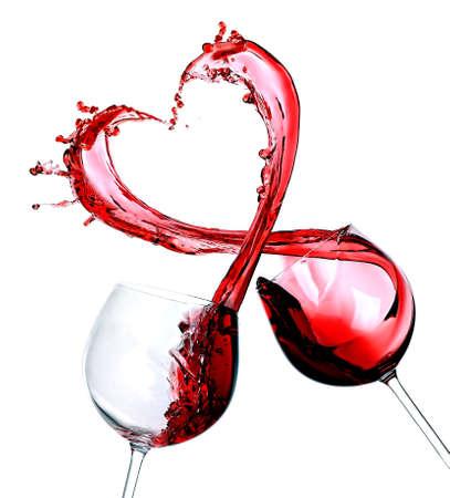 Dos vasos de vino tinto. Splash del corazón Foto de archivo - 54059907