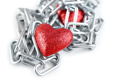 interpersonal: Two red hearts with metal chain isolated on white