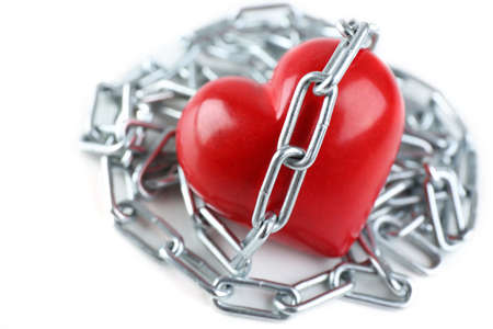 heavy heart: Heart shape with metal chain isolated on white