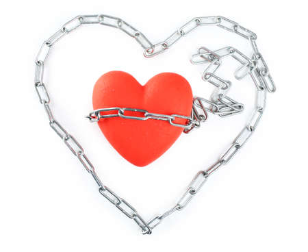 interpersonal: Red heart with metal chain isolated on white Stock Photo
