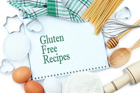allergic ingredients: Basic baking ingredients and kitchen tools near note-book with text Gluten Free Recipes