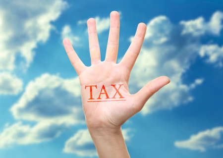 excise: Tax concept. Womans hand with Tax sign, isolated on white