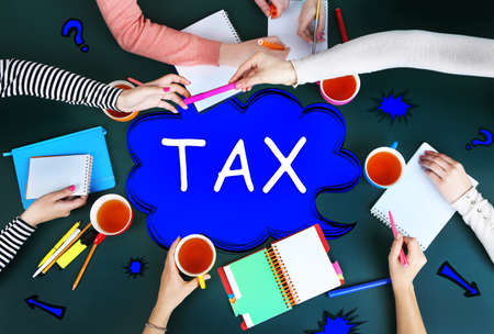 work flow: Tax concept. Creative team for work flow on blackboard background top view Stock Photo