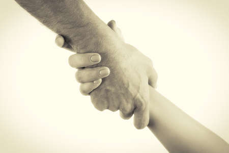 guardianship: Two hands reaching toward each other. Helping concept. Vintage tone