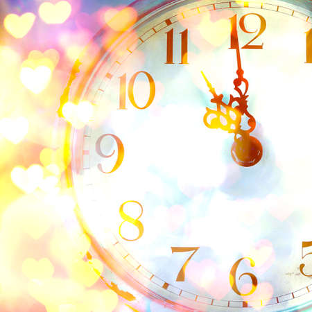chiming: New Years clock with shining background Stock Photo