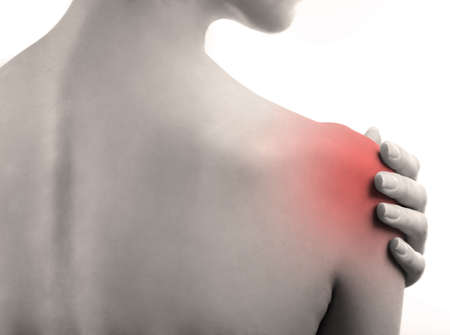 enhanced health: Young woman with shoulder pain close up