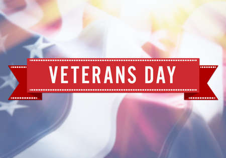 Veterans Day sign on USA flag background Stock Photo