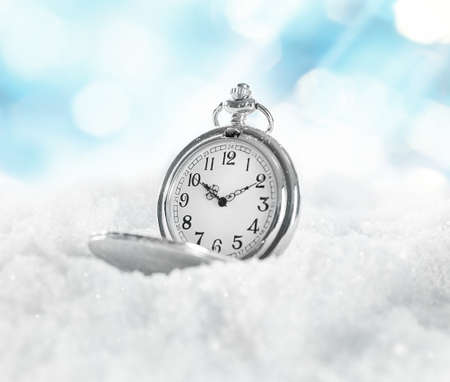 watch over: Pocket watch over white snow background