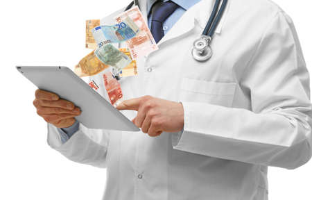 doctor money: Financial concept. Make money on the Internet. Doctor with tablet isolated on white
