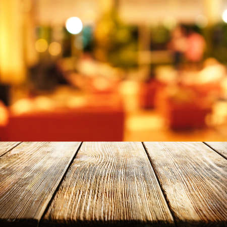 lunch table: Empty wooden table and blurred interior background
