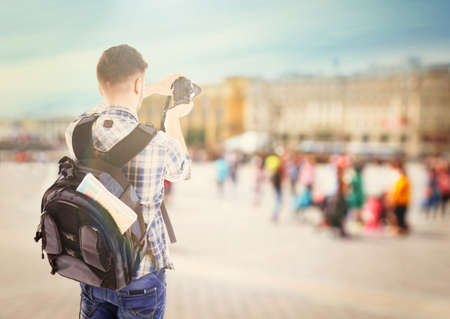 guid: Traveler with camera outside Stock Photo
