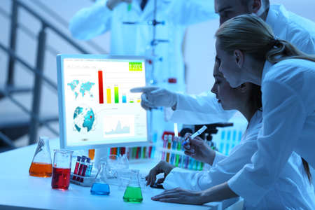 medical laboratory: Young medical technicians working in laboratory Stock Photo