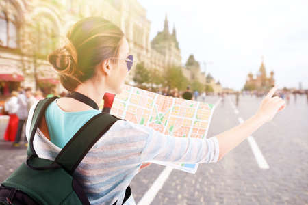 guid: Traveler with map on the street outdoors Stock Photo
