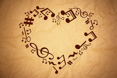 valentine musical note: Heart collected from musical notes on brown background