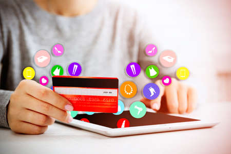Online shopping.Hands with digital tablet and credit card