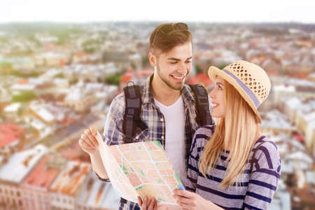Young couple of travelers on cityscape background Stock Photo