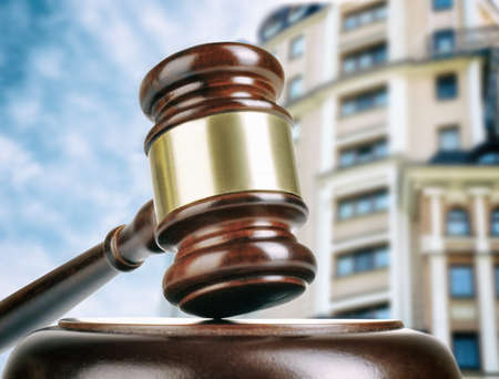 sequestration: Gavel on building background. Auction concept