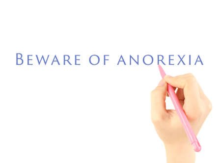 anorexia: Human hand writing text Beware of Anorexia on transparent whiteboard Stock Photo