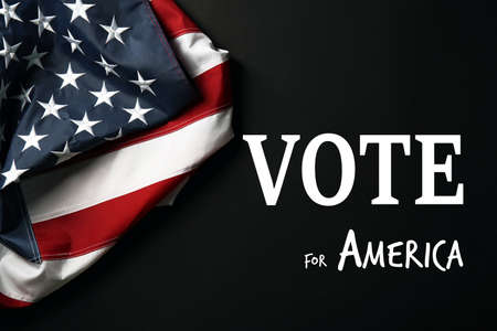 electioneering: Text Vote for America and USA National Flag on black background Stock Photo