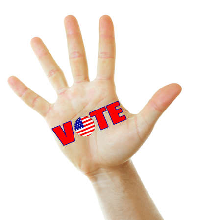 electioneering: Male hand with word Vote isolated on white