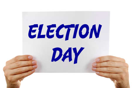 electioneering: Hands holding card with text Election Day isolated on white