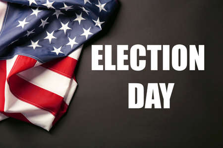 electioneering: Text Election Day and USA National Flag on black background Stock Photo