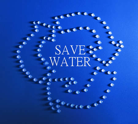 made of water: Save water concept. Recycle sign made of water drops and text on blue background Stock Photo