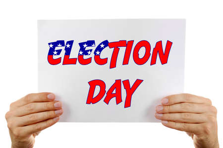 electioneering: Hands holding card with Election Day text isolated on white Stock Photo