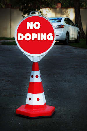 Stop doping concept. Sign NO DOPING on city street