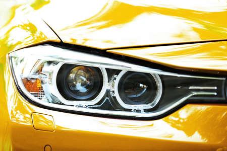 yellow car: Headlights of yellow car Stock Photo