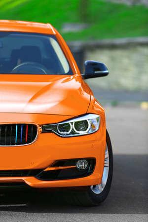 Orange car on road Reklamní fotografie