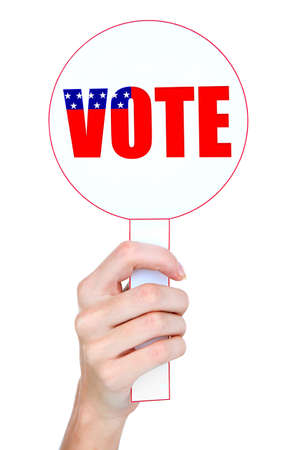 electioneering: Hand holding vote sign isolated on white Stock Photo