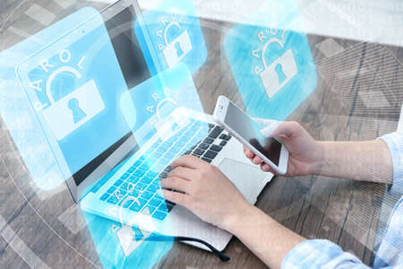lockout: Woman working on laptop with icons security on virtual display. Technology, internet and networking concept. Stock Photo