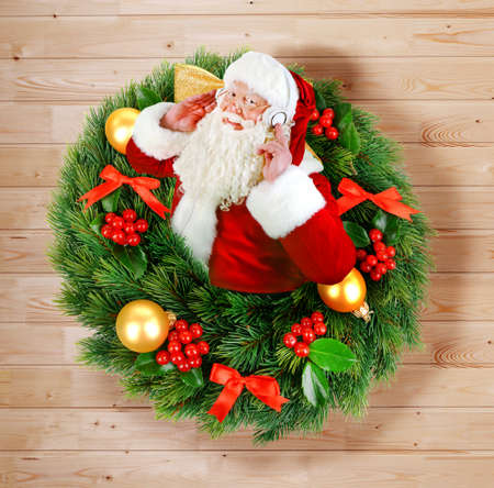 appearing: Santa Claus appearing from Christmas wreath