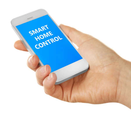 スマート ホームのアプリは手に携帯電話にインストールします。スマート ホーム コントロール概念。 写真素材