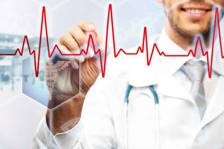 medical drawing: Doctor drawing cardiogram on virtual screen. Medical concept Stock Photo