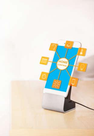 temperature controller: Smart home control concept. Smart phone near bed