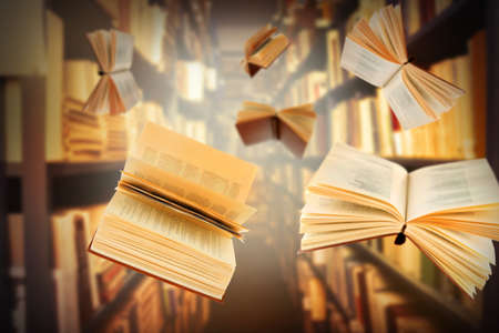 Flying open books in library Stock Photo
