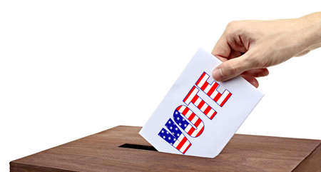electioneering: Human hand inserting bulletin in ballot box isolated on white