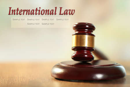 international law: Wooden judges gavel on wooden table, close up. International law concept