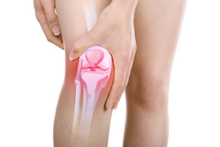 enhanced health: Young woman with knee pain isolated on white Stock Photo